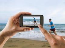 Бежать для утехи на пляже Стоковое фото RF