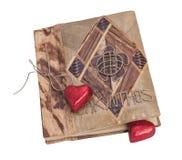Бежевая книга и красное сердце Стоковая Фотография