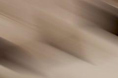 Бежевая коричневая нерезкость предпосылки градиента Стоковое Изображение