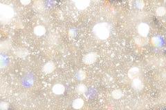 Бежевая предпосылка с sparkles, bokeh Стоковое Фото