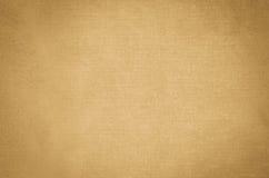 Бежевая текстура конспекта искусства покрашенная на предпосылке холста искусства Стоковые Изображения