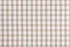 Бежевая checkered ткань. Текстура скатерти Стоковая Фотография