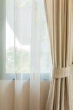 Бежевый занавес окном Стоковая Фотография