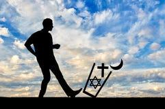 2 безбожника людей бросают все вероисповедания в погани Стоковая Фотография