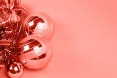 Безделушки рождества тонизированные в коралле стоковое фото