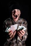 Бездомная персона с деньгами Стоковое Фото