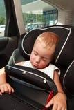 Безопасность мальчика и автокресла Стоковые Фото