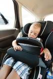Безопасность мальчика и автокресла Стоковое Изображение