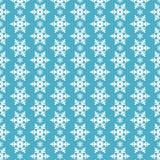 Безшовная голубая картина с снежинками. Стоковое Фото
