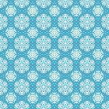 Безшовная голубая картина с снежинками. Стоковые Изображения RF