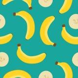 Безшовная картина вектора с желтыми бананами на голубой предпосылке свежие фрукты тропические Иллюстрация вектора для Стоковая Фотография RF