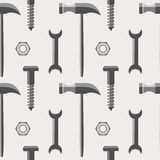 Безшовная картина вектора с инструментами Симметричная предпосылка с молотками, винтами, гайками и ключами на сером фоне Стоковая Фотография RF