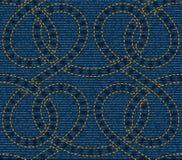 Безшовная картина вышитая на голубой предпосылке текстуры джинсовой ткани Стоковое фото RF