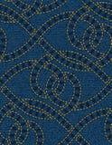 Безшовная картина вышитая на голубой предпосылке текстуры джинсовой ткани Стоковые Фото