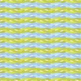 Безшовная картина голубых и темных желтых волнистых линий Стоковые Фотографии RF