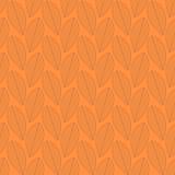 Безшовная картина листьев на оранжевой предпосылке Стоковое Изображение