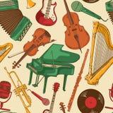 Безшовная картина красочных музыкальных инструментов Стоковое Фото