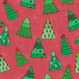 Безшовная картина рождества с красной предпосылкой Стоковые Изображения RF