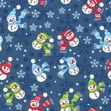 Безшовная картина рождества с снеговиками и снежинками Стоковое Изображение