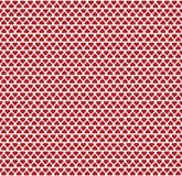 Безшовная картина состоя из малых красных сердец Стоковые Фото