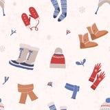 Безшовная картина со связанными ботинками одеяния и зимы на светлой предпосылке Фон с шерстяной сезонной одеждой и стоковые фотографии rf