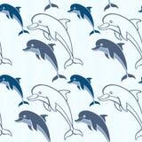 Безшовная картина с дельфинами шаржа Стоковое фото RF