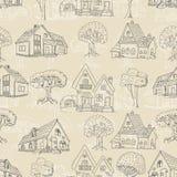 Безшовная картина с много домами и деревьев Стоковые Фото