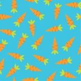 Безшовная картина с морковами и голубой предпосылкой Стоковое Фото