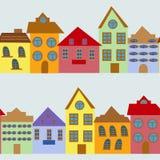 Безшовная картина с домами шаржа Стоковые Изображения RF