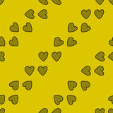 Безшовная картина с сердцами на желтой предпосылке Стоковые Фото