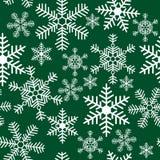 Безшовная картина с снежинками на предпосылке Стоковые Изображения RF