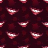 Безшовная картина с страшными улыбками вампиров Стоковые Изображения