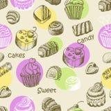 Безшовная картина с тортами и помадками помадки Стоковые Изображения
