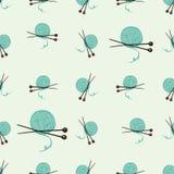 Безшовная картина с шариком пряжи и вязать иглами Стоковое Изображение