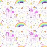 Безшовная картина с яркими милыми единорогами и радугами Стоковые Изображения
