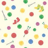Безшовная предпосылка картины красочных шерстяных шариков потока и вязать пару носок Стоковые Изображения