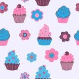 Безшовная предпосылка милых декоративных пирожных с цветками Стоковое Изображение