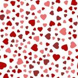 Безшовная предпосылка с различными покрашенными сердцами Стоковое фото RF