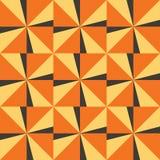Безшовная предпосылка с желтыми оранжевыми треугольниками Стоковая Фотография RF