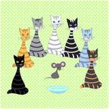 Безшовная предпосылка с пестроткаными котами Стоковая Фотография
