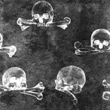 Безшовная предпосылка хеллоуина grunge с человеческими черепами Стоковое Изображение RF