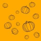 Безшовная простая картина с тыквами на оранжевой предпосылке Стоковые Фото