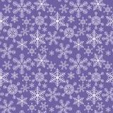 Безшовная текстура рождества со снежинками на голубой предпосылке бесплатная иллюстрация
