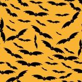 Безшовная текстура с силуэтами летучих мышей. Стоковое Фото