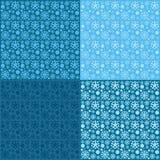 Безшовные картины снежинок на голубой предпосылке Стоковые Фото