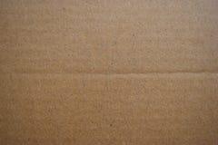 Безшовные текстура коричневой бумаги и предпосылка картона Стоковые Фото