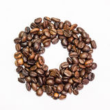 Бейгл от кофейных зерен на белой предпосылке Стоковое Изображение RF
