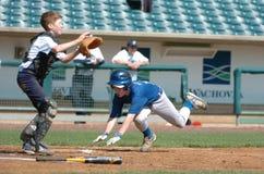 Бейсбольный матч мальчиков средней школы Стоковое Изображение