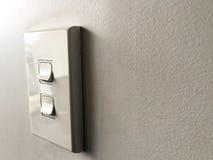 Белая доска переключателя мощности на белой стене Стоковое Изображение RF