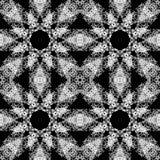 Белая картина орнамента на черной предпосылке стоковая фотография